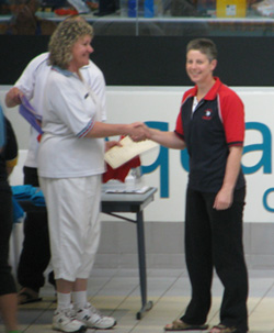 Ann receiving her Million Metres Award