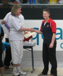 Ann receiving her Million Metres Award
