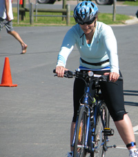 Kristen taking on the cycle leg in the Sprint Triathlon