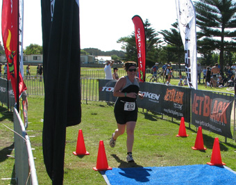 Caroline crossing the finishing line on the Sprint Triathlon